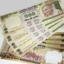 INR rebounds from record low 56.38